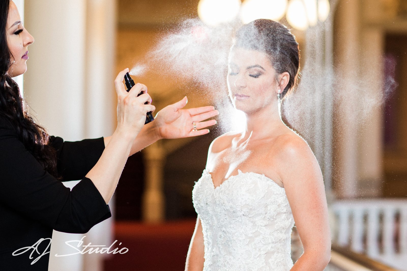 Bride getting makeup done