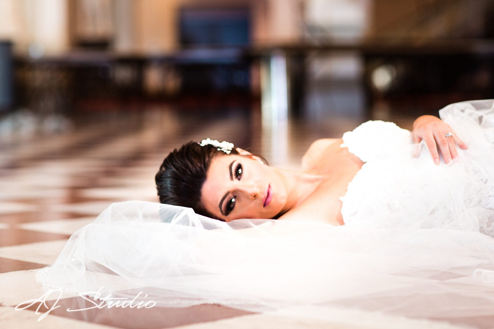Bride laying on the floor in Cincinnati Music Hall